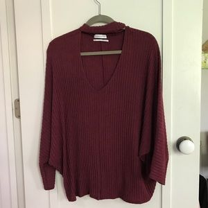 Maroon sweater with chest cutout
